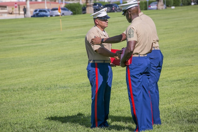 During his retirement ceremony, 1st Sgt. Nelson A. Hidalgo, Company A First Sergeant, 1st Tank Battalion, receives the Meritorious Service Medal at Lance Cpl. Torrey L. Gray Field, Aug. 7, 2015. Hidalgo began his service in the Marine Corps as a basic rifleman with 2nd Battalion, 8th Marine Regiment, in 1995. (Official Marine Corps photo by Pfc. Levi Schultz/Released)