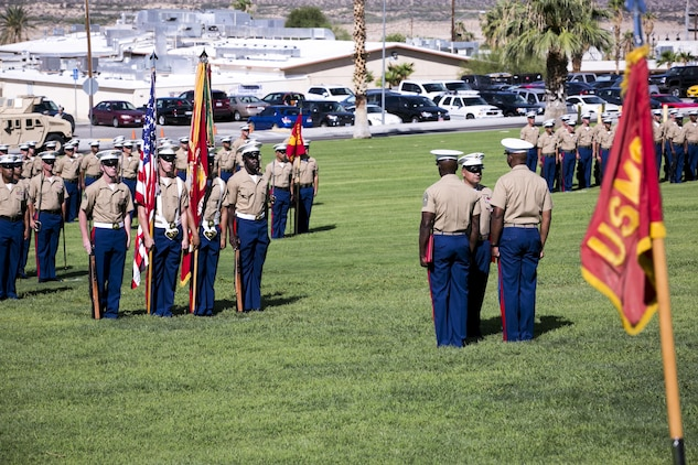 Marines with 1st Tank Battalion stand in formation while 1st Sgt. Nelson A. Hidalgo, Company A First Sergeant, 1st Tanks, receives the Meritorious Service Medal during his retirement ceremony at Lance Cpl. Torrey L. Gray Field, Aug. 7, 2015. Over the course of his career Hidalgo was meritoriously promoted four times. (Official Marine Corps photo by Pfc. Levi Schultz/Released)