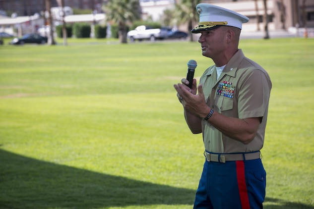 Lt. Col. Lee M. Rush, commanding officer, 1st Tank Battalion, speaks during a retirement ceremony for 1st Sgt. Nelson A. Hidalgo, Company A First Sergeant, 1st Tanks, at Lance Cpl. Torrey L. Gray Field, Aug. 7, 2015. Hidalgo retired after 20 years of service in the Marine Corps. (Official Marine Corps photo by Pfc. Levi Schultz/Released)
