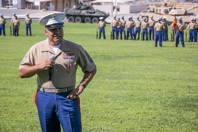 1st Sgt. Nelson A. Hidalgo, Company A First Sergeant, 1st Tank Battalion, thanks the Marines and sailors he served with throughout his 20-year career during his retirement ceremony at Lance Cpl. Torrey L. Gray Field, Aug. 7, 2015. Looking back on his career, Hidalgo attributed his growth as a Marine to both the good times and the challenges he faced along the way. (Official Marine Corps photo by Pfc. Levi Schultz/Released)