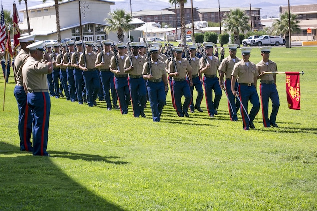 Marines with 1st Tank Battalion perform a pass in review during a retirement ceremony for 1st Sgt. Nelson A. Hidalgo, Company A First Sergeant, 1st Tanks, at Lance Cpl. Torrey L. Gray Field, Aug. 7, 2015. Pass in reviews are a long-standing military tradition that originated as a way for a newly appointed commander to inspect his troops. (Official Marine Corps photo by Pfc. Levi Schultz/Released)