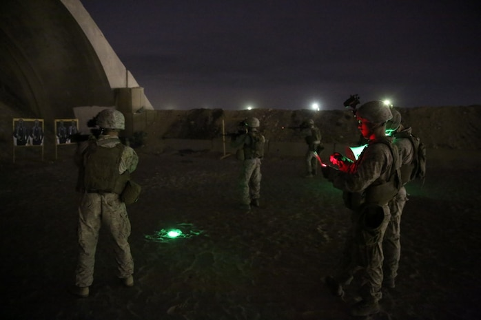 U.S. Marines with Headquarters Company, 3rd Battalion, 7th Marine Regiment, Special Purpose Marine Air-Ground Task Force-Crisis Response-Central Command, engage close-range targets during a night shoot in Southwest Asia, Aug. 8, 2015. These Marines provide security at one of the SPMAGTF operating bases in the Middle East. The Marines and Sailors of SPMAGTF-CR-CC offer rapid, task-organized solutions to the commander of USCENTCOM across an area of operations spanning 20 countries.