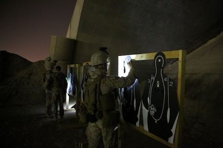 U.S. Marines with Headquarters Company, 3rd Battalion, 7th Marine Regiment, Special Purpose Marine Air-Ground Task Force-Crisis Response-Central Command, observe their shot groups during a night range in Southwest Asia, Aug. 8, 2015. These Marines provide security at one of the SPMAGTF operating bases in the Middle East. The Marines and Sailors of SPMAGTF-CR-CC offer rapid, task-organized solutions to the commander of USCENTCOM across an area of operations spanning 20 countries.
