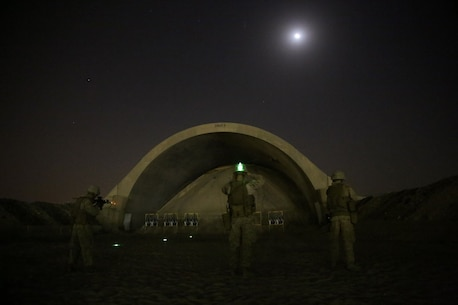 U.S. Marines with Headquarters Company, 3rd Battalion, 7th Marine Regiment, Special Purpose Marine Air-Ground Task Force-Crisis Response-Central Command, shoot targets from 25 meters during a night range in Southwest Asia, Aug. 8, 2015. These Marines provide security at one of the SPMAGTF operating bases in the Middle East. The Marines and Sailors of SPMAGTF-CR-CC offer rapid, task-organized solutions to the commander of USCENTCOM across an area of operations spanning 20 countries.