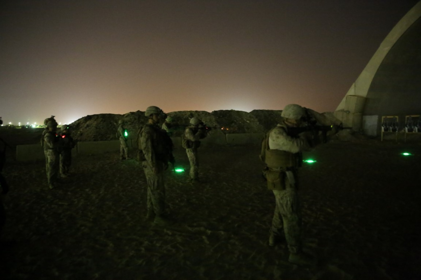 U.S. Marines with Headquarters Company, 3rd Battalion, 7th Marine Regiment, Special Purpose Marine Air-Ground Task Force-Crisis Response-Central Command, fire their rifles during a night range in Southwest Asia, Aug. 8, 2015. These Marines provide security at one of the SPMAGTF operating bases in the Middle East. The Marines and Sailors of SPMAGTF-CR-CC offer rapid, task-organized solutions to the commander of USCENTCOM across an area of operations spanning 20 countries.