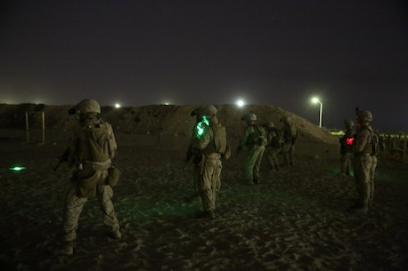 U.S. Marines with Headquarters Company, 3rd Battalion, 7th Marine Regiment, Special Purpose Marine Air-Ground Task Force-Crisis Response-Central Command, await the command to commence firing during a night range in Southwest Asia, Aug. 8, 2015. These Marines provide security at one of the SPMAGTF operating bases in the Middle East. The Marines and Sailors of SPMAGTF-CR-CC offer rapid, task-organized solutions to the commander of USCENTCOM across an area of operations spanning 20 countries.