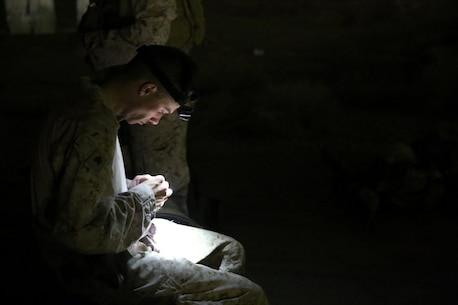 U.S. Marine Sgt. Jeffrey Walsh, with Headquarters Company, 3rd Battalion, 7th Marine Regiment, Special Purpose Marine Air-Ground Task Force-Crisis Response-Central Command from Detroit, loads a magazine before shooting at a night range in Southwest Asia, Aug. 8, 2015. The Headquarters Company Marines provide security at one of the SPMAGTF operating bases in the Middle East. The Marines and Sailors of SPMAGTF-CR-CC offer rapid, task-organized solutions to the commander of USCENTCOM across an area of operations spanning 20 countries.