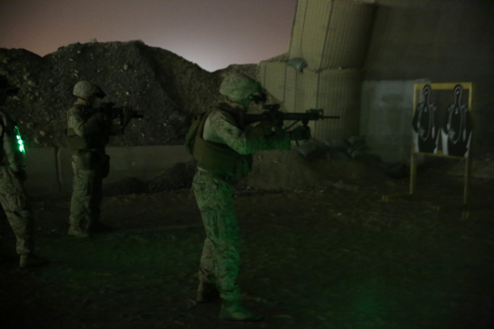 U.S. Marines with Headquarters Company, 3rd Battalion, 7th Marine Regiment, Special Purpose Marine Air-Ground Task Force-Crisis Response-Central Command, fire their rifles at close-range targets during a night range in Southwest Asia, Aug. 8, 2015. These Marines provide security at one of the SPMAGTF operating bases in the Middle East. The Marines and Sailors of SPMAGTF-CR-CC offer rapid, task-organized solutions to the commander of USCENTCOM across an area of operations spanning 20 countries.