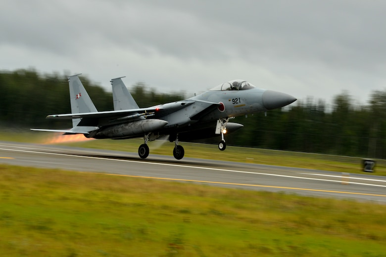 A Japan Air Self-Defense Force (JASDF) F-15J/DJ Eagle lifts off from the Eielson Air Force Base, Alaska, flightline Aug. 10, 2015, as part of the first simulated combat sortie of RED FLAG-Alaska 15-3. The JASDF is participating in this Pacific Air Forces commander-directed field training exercise for U.S. and partner nation forces, providing combined offensive counter-air, interdiction, close air support, and large force employment training in a simulated combat environment. (U.S. Air Force photo by Airman 1st Class Kyle Johnson/Released)