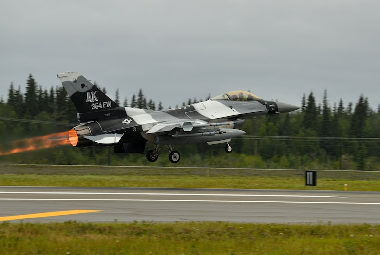 A U.S. Air Force F-16 Fighting Falcon assigned to the 18th Aggressor Squadron takes off from the Eielson Air Force Base, Alaska, flightline Aug. 10, 2015, as part of the first simulated combat sortie of RED FLAG-Alaska 15-3. The Aggressors are participating as opposing forces during this Pacific Air Forces commander-directed field training exercise for U.S. and partner nation forces, providing combined offensive counter-air, interdiction, close air support, and large force employment training in a simulated combat environment. (U.S. Air Force photo by Airman 1st Class Kyle Johnson/Released)