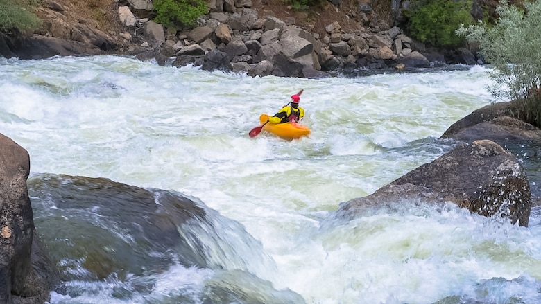 A kayaker paddles his way through whitewater on the North Fork Payette River, Idaho, July 10, 2015. Rafting, tubing and kayaking are some of the most popular activities to do on the river. (U.S. Air Force photo by Airman 1st Class Connor J. Marth/RELEASED)