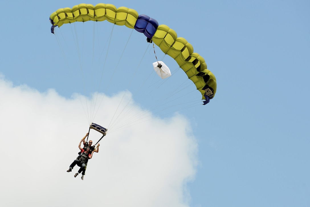 A U.S. Air Force Airman parachutes after freefalling out of an airplane at a 20th Force Support Squadron skydiving event at Walterboro, S.C., Aug. 1, 2015. Three trips were scheduled to take Team Shaw members skydiving at an affordable cost. (U.S. Air Force photo by Senior Airman Michael Cossaboom/Released)
