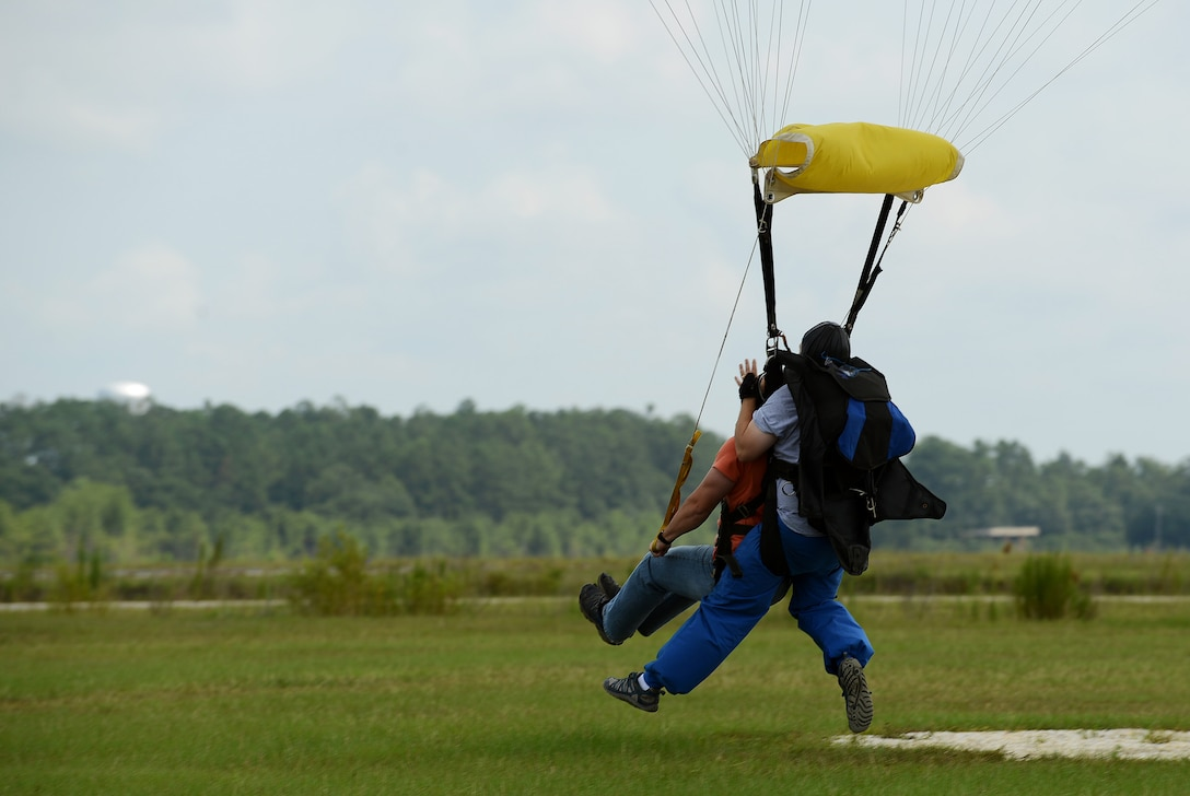 U.S. Air Force Airman 1st Class Ryan Armitage, 20th Force Support Squadron force management technician, is safely brought to the ground after jumping out of an airplane during a 20th FSS skydiving event at Walterboro, S.C., Aug. 1, 2015. Approximately 15 Team Shaw members participated in the second of three skydiving trips. (U.S. Air Force photo by Senior Airman Diana M. Cossaboom/Released)
