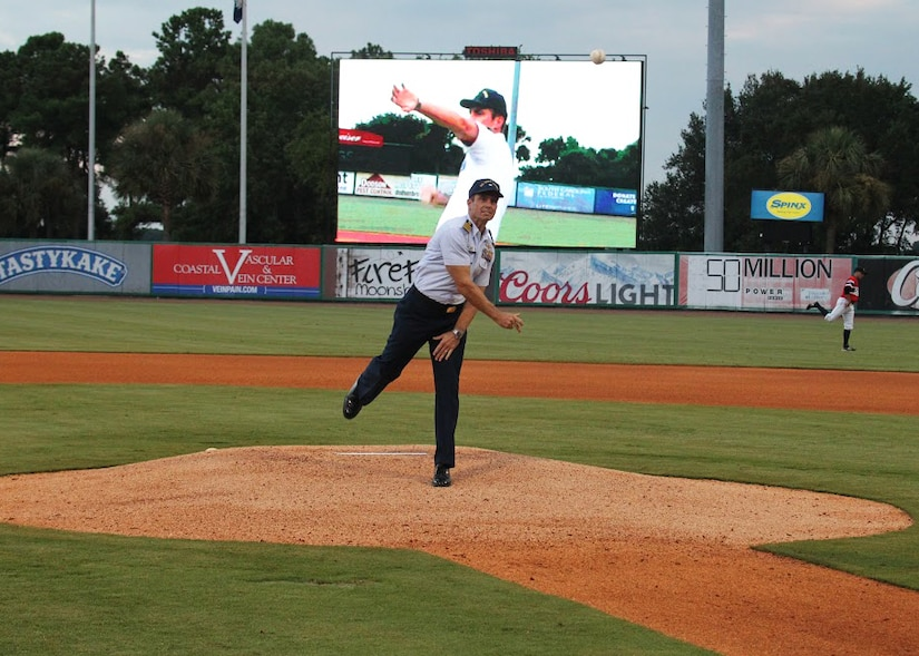 Captain Gary Tomasulo, United States Coast Guard Sector Charleston commander, throws out the first pitch at the Charleston RiverDogs baseball game honoring the U.S. Coast Guard's 225th birthday on August 8, 2015. Over the past two and a quarter centuries the Coast Guard missions have grown from enforcing revenue laws to ensuring maritime safety, security and stewardship on the U.S. coastal shores and across the globe. The RiverDogs lost to Savannah 8 – 1. (Charleston RiverDogs photo/Vin Duffy)