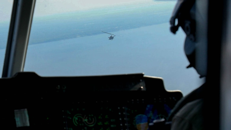 A UH-1Y Huey flies with an AH-1W Super Cobra during a training exercise testing a digital interoperability system at Marine Corps Air Station Cherry Point, N.C., July 24, 2015. Digital interoperability is the technology capable of increasing prowess on the battlefield. The exercise included Marine Light Attack Helicopter Squadron 467, Marine Unmanned Aerial Vehicle Squadron 2, and U.S. Marine Corps Forces, Special Operations Command, testing a LINK 16 conversion system for one of the first times within an explicitly rotary-wing exercise.