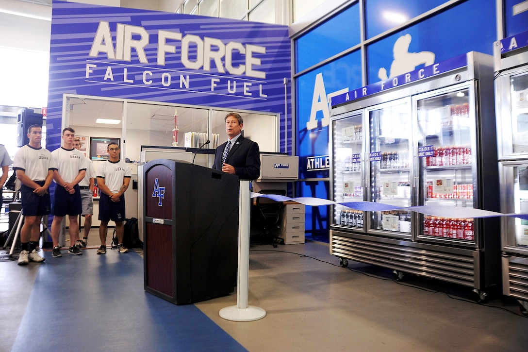 Jim Knowlton, the U.S Air Force Academy's athletic director, speaks at the Falcon Fuel ribbon cutting ceremony Aug. 5, 2015. The Falcon Fuel program provides cadets with extra nutrition by placing 12 healthy food stations near cadet workout areas. (U.S. Air Force photo/Mike Kaplan)