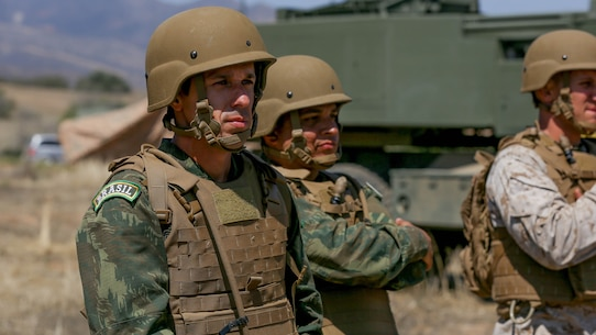 Brazilian Major Rafael Pires Ferreira, an artillery officer with Corpo de Fuzileiros Navais, observes the tactical capabilities of 5th Battalion, 11th Marine Regiment's M142 High-Mobility Artillery Rocket System aboard Marine Corps Base Camp Pendleton, Calif., Aug. 9, 2015. The two Brazilian officers visited to share and discuss information on military operations, unit structure and different weapons systems.