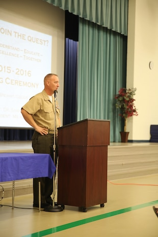 Colonel Peter D. Buck addresses teachers aboard Laurel Bay family housing during an opening ceremony for the new school year at Middleton S. Elliott Elementary School, Aug. 10. Buck expressed his gratitude towards the Laurel Bay school system for their support to the community. Buck is the commanding officer for Marine Corps Air Station Beaufort. (U.S. Marine Corps photo by Lance Cpl. Jonah Lovy/Released)