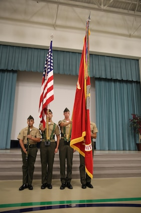 The Color Guard presents the Marine Corps colors at during the opening ceremony for the new school year at Middleton S. Elliott Elementary School, Aug. 10. The ceremony welcomed staff and faculty back from summer vacation while looking forward at what the new school year will hold.  The Marines are with Marine Corps Air Station Beaufort. (U.S. Marine Corps photo by Lance Cpl. Jonah Lovy/Released)