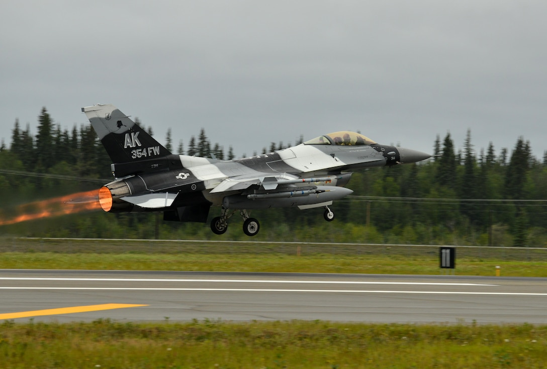 A U.S. Air Force F-16 Fighting Falcon assigned to the 18th Aggressor Squadron takes off from the Eielson Air Force Base, Alaska, flightline Aug. 10, 2015, as part of the first simulated combat sortie of RED FLAG-Alaska, 15-3. The Aggressors are participating as opposing forces during this Pacific Air Forces commander-directed field training exercise for U.S. and partner nation forces, providing combined offensive counter-air, interdiction, close air support, and large force employment training in a simulated combat environment. (U.S. Air Force photo by Airman 1st Class Kyle Johnson/Released)