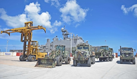 Marines from the 31st Marine Expeditionary Unit (MEU) stage vehicles in front of the amphibious dock landing ship USS Ashland (LSD 48), during disaster relief efforts in Saipan after Typhoon Soudelor. 31st MEU are embarked on the amphibious dock landing ship USS Ashland (LSD 48) and are on patrol in the U.S. 7th Fleet area of operations. (U.S. Navy photo by Mass Communication Specialist 3rd Class David A. Cox/Released)