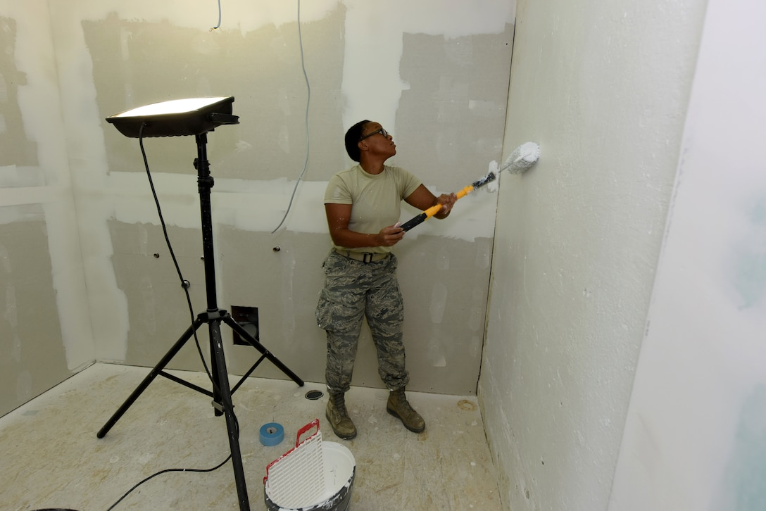 U.S. Air Force Senior Airman Kimberly Cooper, 140th Civil Engineer Squadron, Colorado Air National Guard (COANG), applies the first coat of paint to a newly constructed wall during the restoration phase of a historically old barn into a usable range facility to be used by Slovenian Armed Forces and NATO countries for joint, multinational training and exercises at Pocek Range, near Postonja, Slovenia, July 22, 2015. The Colorado-Slovenia State partnership focuses on the continued relationship development between the two NATO countries and an emphasis on increasing the capabilities of Slovenian ranges. (U.S. Air National Guard photo by Senior Airman Michelle Y. Alvarez-Rea/Released)