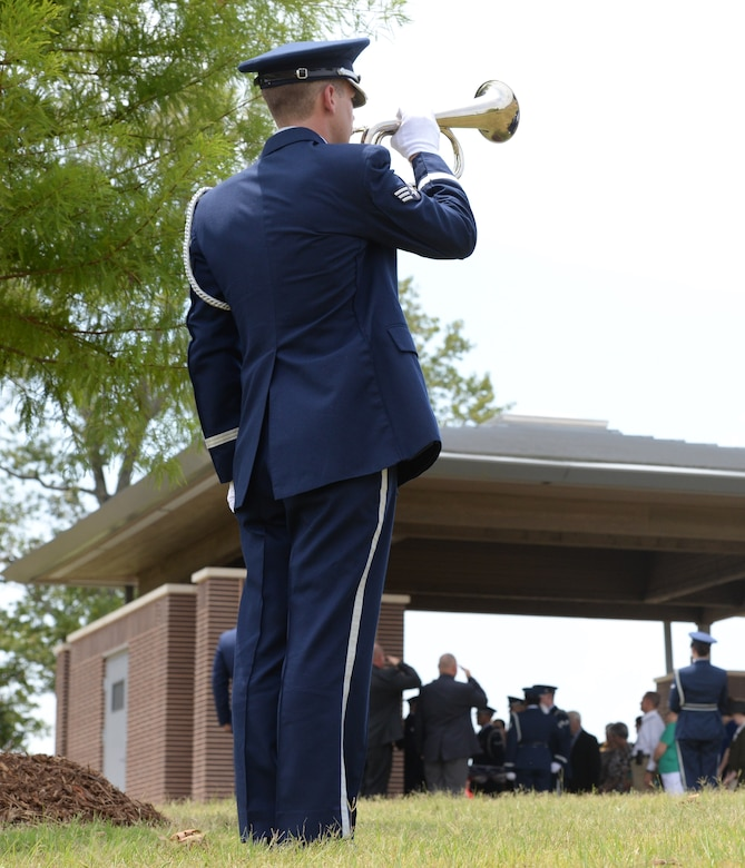 Senior Airman Justin Keller, Columbus Air Force Base Honor guardsman, plays Taps for a Missing in Action ceremony for Capt. Frederick Partridge Aug. 10 at the Mississippi Veterans Memorial Cemetery. A native of Sumner, Mississippi, Partridge served in both World War II and in Korea in his eight years of service until he was shot down the morning of Aug. 10, 1952. (U.S. Air Force photo/2nd Lt. Lauren Woods)