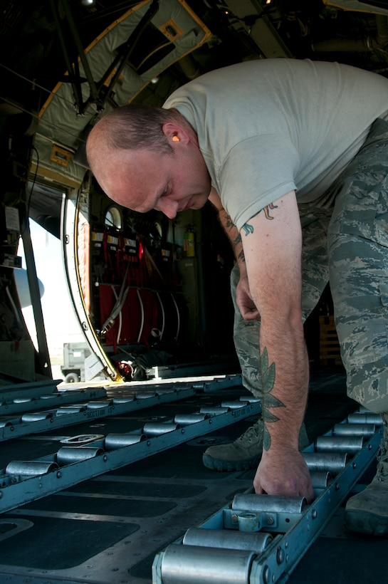 Staff Sgt. Matthew Powell, a 176th Aircraft Maintenance crew chief, reconfigures a C-130 Hercules aircraft on Joint Base Elmendorf-Richardson, Alaska,  Aug. 11, 2015, for an airdrop mission. Alaska Air Guardsmen of the 176th Wing train alongside their international counterparts as part of Red Flag-Alaska 15-3. (Alaska Air National Guard photo by Tech. Sgt N. Alicia Halla/released)