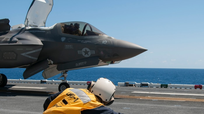 Rear Adm. Cynthia Thebaud, commander of Expeditionary Strike Group Two takes the shooter stance while she launches an F-35B Lightning II off the flight deck of USS Wasp, on the Atlantic Ocean, May 26, 2015. Wasp, with VMFA-121 and VMFAT-501 embarked, is underway conducting the first phase of operational testing for the F-35B aircraft, which will evaluate the full spectrum of F-35B measures of suitability and effectiveness in an at-sea environment.