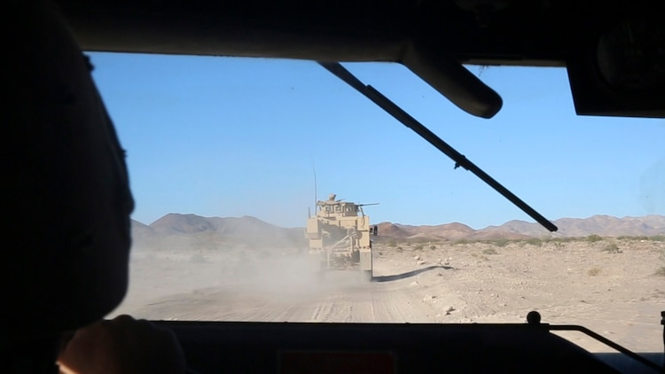Marines with Combat Logistics Battalion 1, Combat Logistics Regiment 1, 1st Marine Logistics Group, convoy during a mounted patrol exercise at Marine Corps Air Ground Combat Center Twentynine Palms, California, Aug. 10, 2015. Marines faced a simulated threat of ambush and improvised explosive device attacks throughout the training exercise.