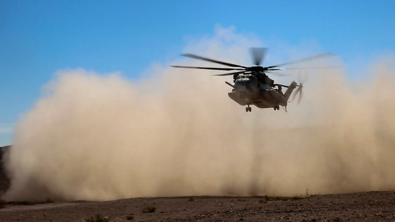 A CH-53E Super Stallion with Marine Heavy Helicopter Squadron 366 descends to a secured landing zone during a simulated casualty evacuation at Marine Corps Air Ground Combat Center Twentynine Palms, California, Aug. 10, 2015. The simulation gave Marines with Combat Logistics Battalion 1, Combat Logistics Regiment 1, 1st Marine Logistics Group an opportunity to prepare for casualty response during future operations.