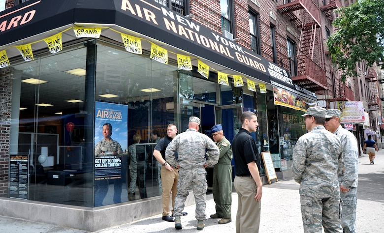 Members of the 105th Air Wing of the New York Air National Guard and recruiters converse outside the new storefront in Bronx, NY. The new career center is the first located outside an air base for the 105th.