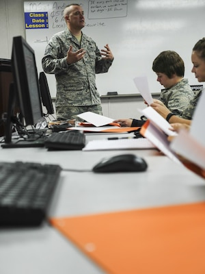 Air Force Master Sgt. Michael Andriacco, Basic Photojournalist Course-Air Force instructor, gives feedback on the writing assignments from Class 050-15 students at the Defense Information School, Fort George G. Meade, Md., Aug. 6, 2015. BPJC-USAF provides instruction in command information, community engagement, media relations, new writing and basic still photography. (DoD photo by Joseph Coslett/Released)