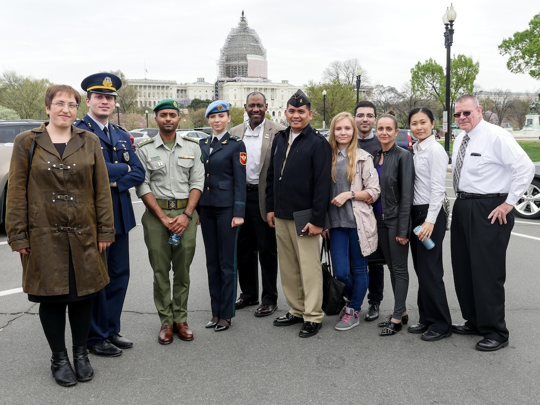 Students from the April Public Affairs Course for International Students pause after a tour of the Newseum in Washington, D.C. The U.S. Capitol is in the background. The nine students represented eight countries - Bulgaria, Turkey, Kuwait, Moldova, Philippines, Ukraine, Macedonia and Taiwan. Pictured with the international students is Rivers Johnson (center), the chief of the international military student office and John Dodd (far right), one of the course instructors. (DoD photo by Joseph Coslett)