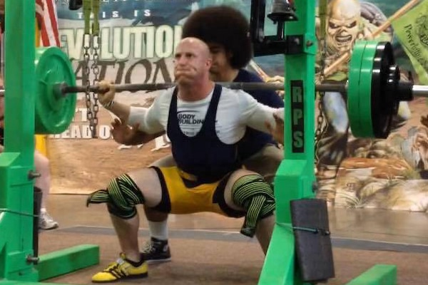 New York Army National Guard Capt. Jeremy Hillyard pushes upward during a powerlifting competition in Rochester, N.Y., August 8, 2015. Hillyard, who began weightlifting while stationed at Guantanamo Bay in 2011-2012, successfully defended his weightlifting records set in previous competitions. Courtesy photo