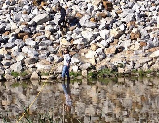Veronica Li (foreground) and Sophia Ma (background) take California Rapid Assessment Method measurements in San Diego Creek in Orange County for the Orange County Transit Authority Measure M2 Freeway Program. (Photo courtesy of Sarvy Mahdavi, US EPA)