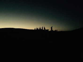 Marines wait for the complete sunset in order to begin their night fire exercise.