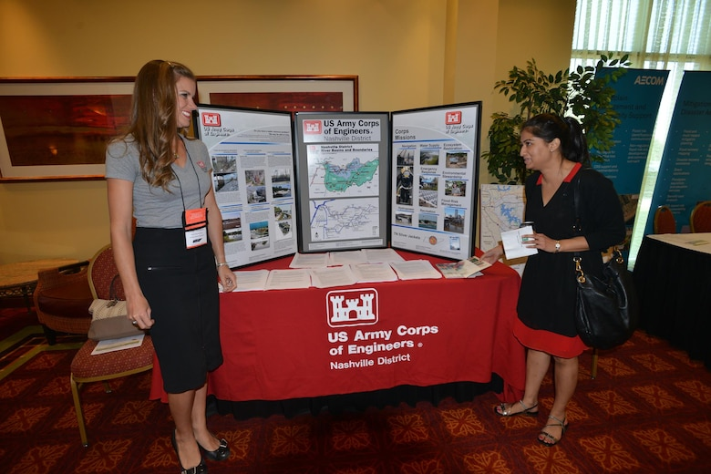 Lacey Thomason, planning project manager, Plans, Formulations Section Nashville District talks with an engineer from the AECOM company at the Corps of Engineers booth during the 6th Annual TN Association of Floodplain Managers Conference in Murfreesboro, Tenn. Aug. 11-14, 2015.