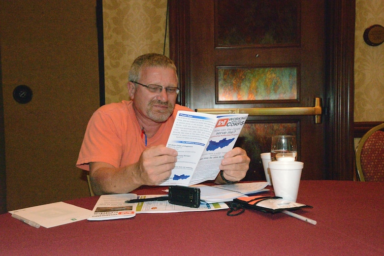 Steve Grant, Public Works Director, City of Soddy-Daisy, Tenn., near Chattanooga reads a brochure from the U.S. ArmyCorps of Engineers Nashville District during a session at the 6th Annual TN Association of Floodplain Managers Conference in Murfreesboro, Tenn. Aug. 11-14, 2015.