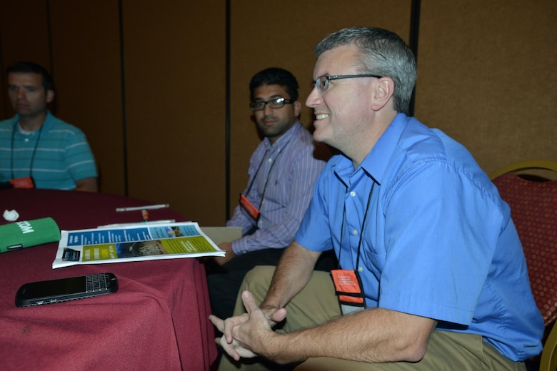 Aras Barzanji (left) Barry Moran  (right) both engineers with the Nashville District attend a session at the 6th Annual TN Association of Floodplain Managers Conference in Murfreesboro, Tenn. Aug. 11-14, 2015. Personnel from the U.S. Army Corps of Engineers Nashville District, Federal Emergency Management Agency, Tennessee Emergency Management Agency, Tennessee Valley Authority, floodplain administrators, community leaders, and technical professionals from throughout Tennessee attended the conference.