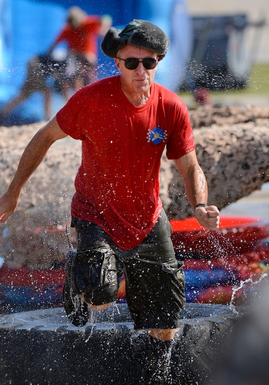 Col. Rick Poplin, 138th Operations Group Commander, runs the obstacle course during the 138th Fighter Wing's combat dining-in held Aug. 1, 2015 at the Tulsa Air National Guard base.  The wing's senior non-commissioned officer's council sponsored the event as a way to enhance camaraderie and promote esprit de corps throughout the ranks.   (U.S. National Guard photo by Master Sgt. Mark A. Moore/Released)