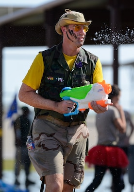 Master Sgt. Jason Stockinger, 138th Communications Flight, seeks out other water fight participants during the 138th Fighter Wing's combat dining-in held Aug. 1, 2015 at the Tulsa Air National Guard base.  The wing's senior non-commissioned officer's council sponsored the event as a way to enhance camaraderie and promote esprit de corps throughout the ranks.   (U.S. National Guard photo by Master Sgt. Mark A. Moore/Released)