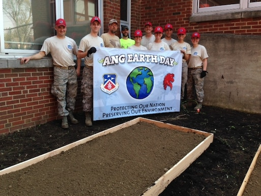 Members of the 200 RED HORSE volunteer to clean up in several locations around Mansfield, OH, as they observe Earth Day on May 7, 2015. Airmen helped clean up local parks and gardens alongside volunteers from the North End Community Improvement Collaborative (NECIC) as well as joining children from schools and community centers.  (courtesy photo)