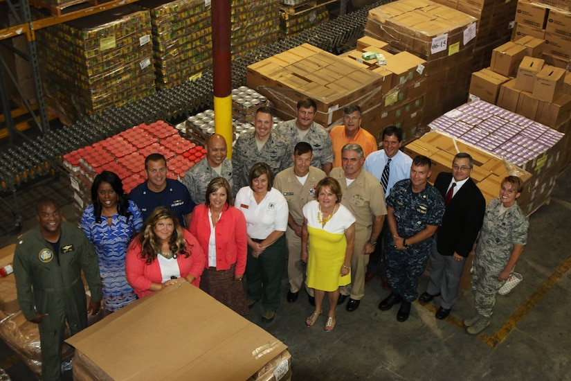 Pictured are members of the Federal Executive Association, including Joint Base Charleston leadership, during their August 6, 2015 meeting at the Lowcountry Food Bank in Charleston, S.C. The FEA supports the Lowcountry Food Bank through the Feds Feed Families program which is currently underway. (Photo by Sara Corbett)