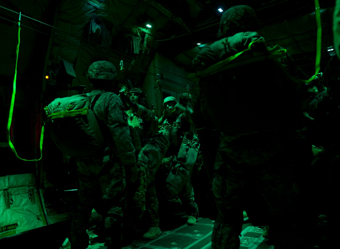 Paratroopers from the Army's 2nd Brigade Combat Team, 82nd Airborne Division, prepare to jump from a C-130J Aug. 6, 2015, near March Air Reserve Base, Calif. The 41st Airlift Squadron along with the 61st Airlift Squadron provided C-130J Combat Airlift for the troops and heavy equipment during Operation Dragon Spear. (U.S. Air Force photo by Senior Airman Scott Poe)