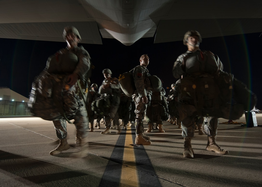 Troops from the Army's 2nd Brigade Combat Team, 82nd Airborne Division board a C-130J Aug. 6, 2015, at March Air Reserve Base, Calif. The C-130J carried more than 50 paratroopers during Operation Dragon Spear. (U.S. Air Force photo by Senior Airman Scott Poe)