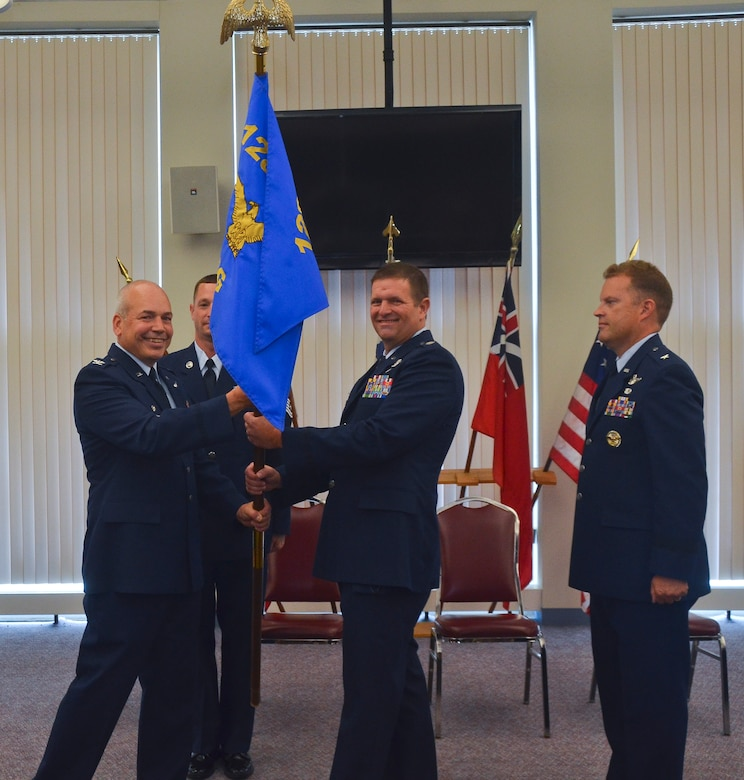 U.S. Air Force Col. Dan Yenchesky, 128th Air Refueling Wing, Wisconsin Air National Guard, wing commander, passes the 128 ARW guideon to Lt. Col. Michael A. Guch during a Change of Command ceremony here August 9, 2015. Guch assumed the position of the 128th Operations Group commander from U.S. Air Force Brig. Gen. Jeffrey V. Cashman. (U.S. Air National Guard photo by Tech. Sgt. Jenna V. Lenski/Released)