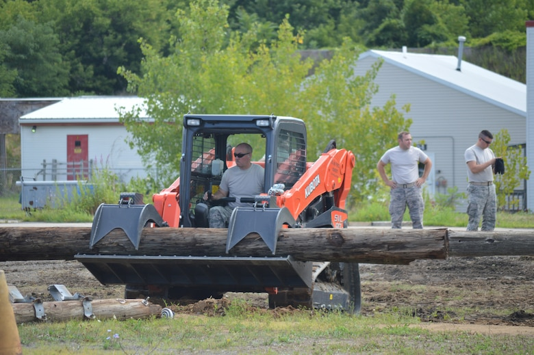 Tech. Sgt. Brian Kissinger, a firefighter with the 109th Airlift Wing, operates a skid steer during training Aug. 12, 2015 at Stratton Air National Guard Base, New  York. The skid steers are part of the equipment package the 109th AW received as part of the debris clearance package to support domestic operations. The 109th Logistic Readiness Squadron's Vehicle Maintenance Flight has been training members throughout the base on the equipment received. (U.S. Air National Guard photo by Tech. Sgt. Catharine Schmidt/Released)