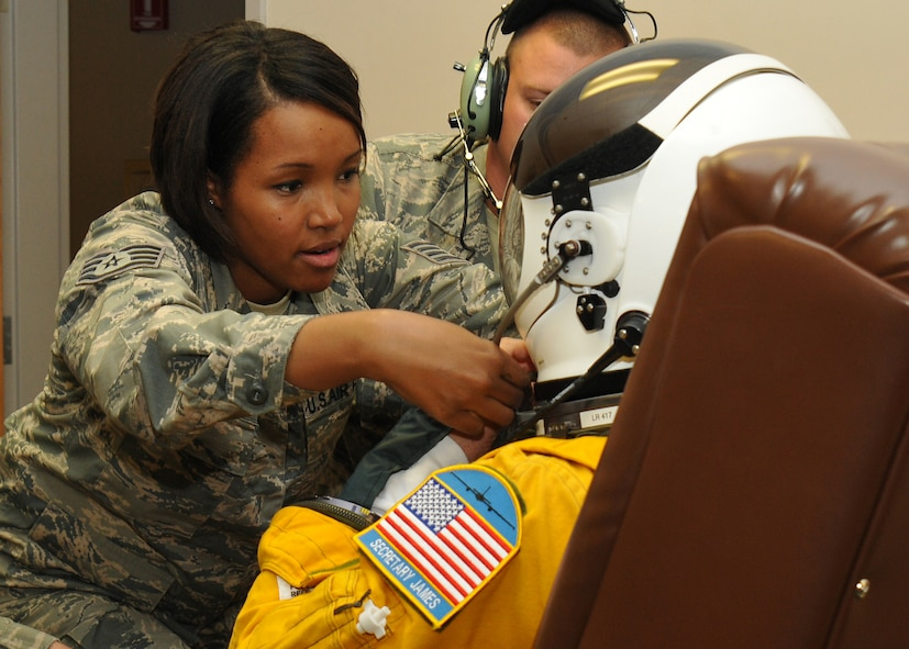 Staff Sgt. Virgie Yi, 9th Physiological Support Squadron assistant non-commissioned officer in charge of launch and recovery, adjusts the helmet for the high-altitude pressure suit of Secretary of the Air Force Deborah Lee James at Beale Air Force Base, California, Aug. 11, 2015. The specialized pressure suit allows U-2 Dragon Lady pilots to safely fly at altitudes reaching 70,000 feet. James visited Beale to receive a first-hand perspective of high-altitude intelligence, surveillance and reconnaissance from collection to dissemination. (U.S. Air Force photo by Senior Airman Dana J. Cable)