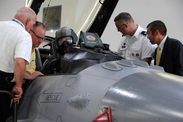 Attendees watch an F-16 fighter pilot from the 113th Air National Guard demonstrate aircrew entry during the Air Force Chemical, Biological, Radiological and Nuclear Defense Demonstration Day on Joint Base Andrews, Md., Aug. 5, 2015. The event gave an overview of Air Force CBRN defense capabilities to Office of the Secretary of Defense and joint leaders who directly influence DoD investment decisions in new CBRN defense technologies. (U.S. Air Force photo/Staff Sgt. Matt Davis)